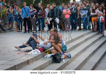 Ukraine, Kiev - September 11,2013: Homeless Couple Watching A Concert During Mass Submission To The
