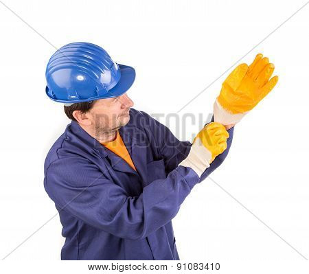 Worker put on the glove.