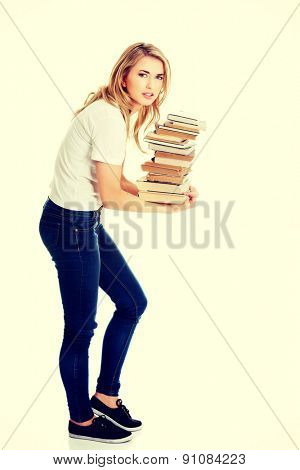 Student woman with books in hand