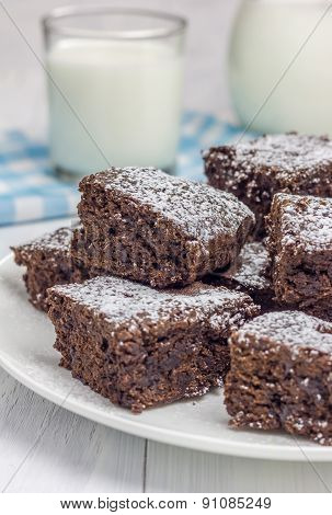 Sugar Powdered Homemade Brownies With Glass Of Milk