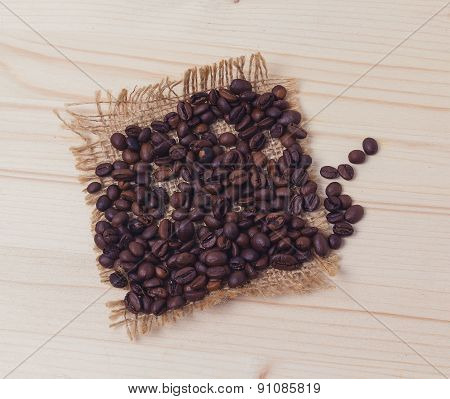Coffee Beans On A Wooden Board