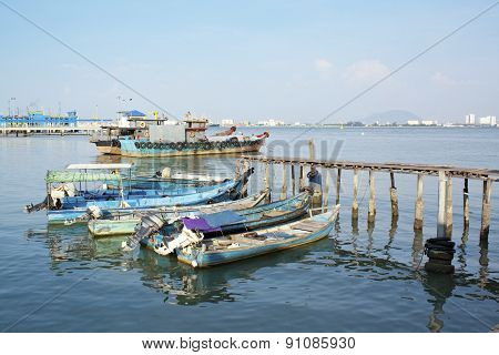 Wooden Fisherman Boat On Water