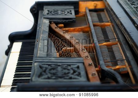 Old Piano Detail With Keyboard, Wooden Carved Ornament And Mechanics