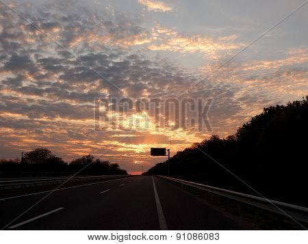 Cloudy sky over night highway