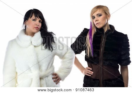 Photo of two women in fake fur coats