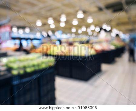 Blurred Supermarket with fruit shelf display