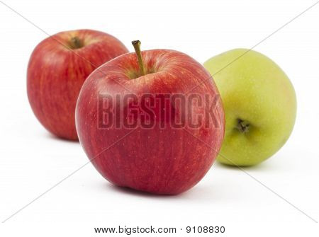 Two Red And One Green Apples On White