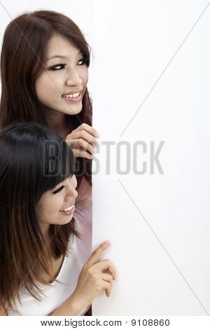 Two Girls And Blank Sign