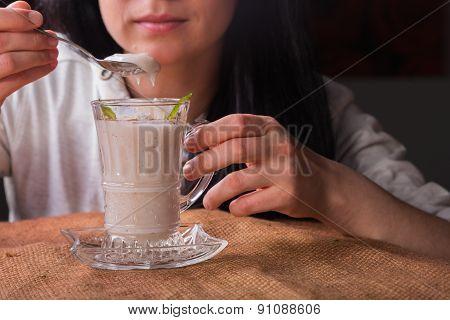 Woman eating dairy dessert spoon