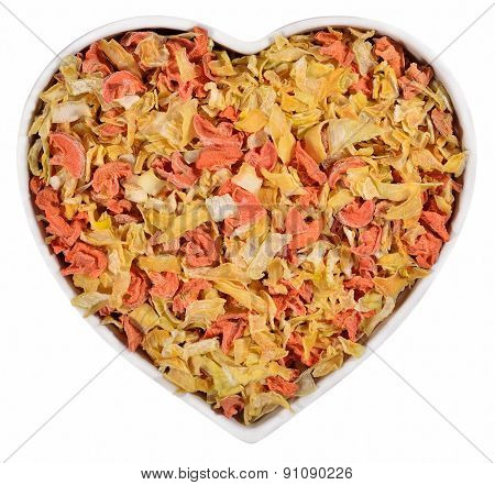 Dried Carrots And Onions In Plate In The Form Of Heart On A White