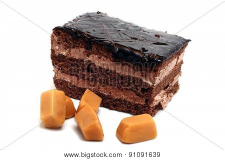 Small Chocolate Cake And Butterscotch Isolated On A White Background