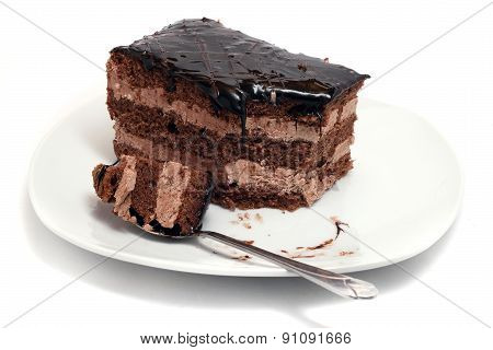 Small Chocolate Cake On A White Plate