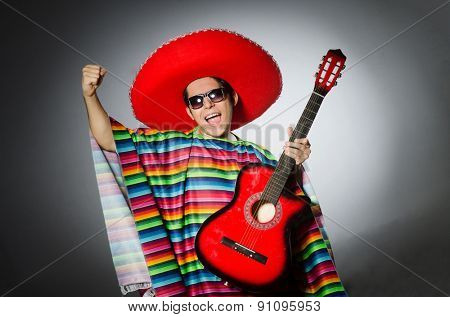 Man in red sombrero playing guitar