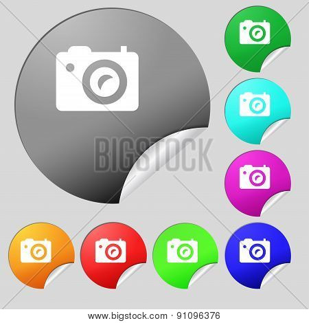 Digital Photo Camera  Icon Sign. Set Of Eight Multi-colored Round Buttons, Stickers. Vector