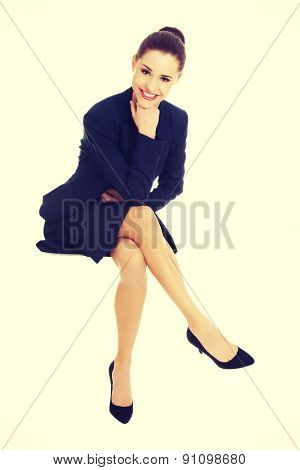 Sign people. Businesswoman sitting on blank billboard placard sign.
