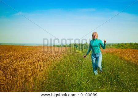 Girl Which Runs Across The Field