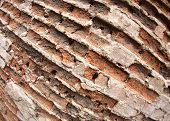 pic of fragmentation  - Fragment of the old wall of the destroyed bricks with wide angle distortion view closeup - JPG