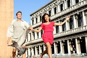 foto of piazza  - Couple in love having playful fun in Venice travel holding hands running laughing in Venice - JPG