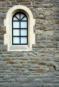 picture of wall-stone  - arch window set in an old stone wall - JPG