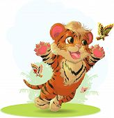 stock photo of tiger cub  - cub playing with butterflies in the meadow - JPG