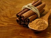 foto of cinnamon sticks  - fragrant cinnamon sticks and ground spices on a wooden background - JPG