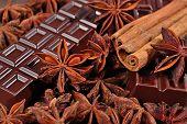 image of cinnamon sticks  - Chocolate star anise and cinnamon sticks close up as background - JPG