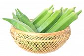 foto of okras  - Okra fruit in bamboo basket on white background - JPG
