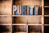 pic of purity  - The word PURITY written in vintage wooden letterpress type in a wooden type drawer - JPG