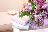 stock photo of vase flowers  - Beautiful lilac flowers in vase on table of interior background - JPG