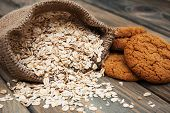 picture of oats  - Oatmeal cookies with oat flakes on a old wooden background - JPG