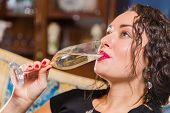foto of champagne glass  - Beautiful young brunette woman drinking champagne. Gorgeous girl holding a glass of champagne. ** Note: Visible grain at 100%, best at smaller sizes - JPG