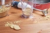 stock photo of cake-mixer  - beatered cookies for making cakes on wooden table - JPG