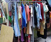 pic of flea  - Used second hand summer clothes on flea market - JPG