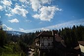 image of twisty  - Mountain town house on a hill below the house a small mountain stream - JPG
