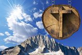 image of italian alps  - Wooden Christian cross on a section of tree trunk hanging from a metal chain - JPG