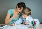 foto of homework  - mother helping his son to do homework - JPG