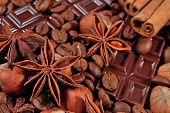stock photo of cinnamon sticks  - Coffee chocolate star anise hazelnuts and cinnamon sticks close up as background  - JPG