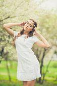 foto of wearing dress  - Beautiful Girl wearing white dress in spring garden - JPG