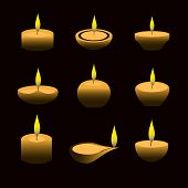 stock photo of candle flame  - lighting wax diwali candles with flame at night eps10 - JPG