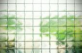 stock photo of grating  - Green retro abstract background made of translucent glass with grating - JPG