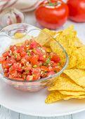 pic of nachos  - Bowl of fresh homemade salsa with nachos - JPG