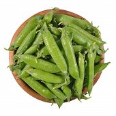 picture of green pea  - Fresh green pea pods in a wooden bowl on a white background - JPG