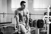 pic of abdominal muscle man  - A man pumping abdominal muscles in the gym - JPG