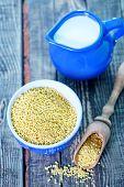 foto of porridge  - millet porridge in bowl and on a table - JPG