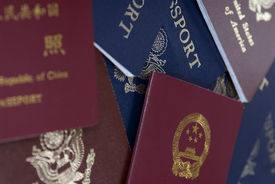 stock photo of passport template  - passports lay on a table ready for the next adventure - JPG