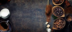 foto of pot roast  - Top view of three different varieties of coffee beans on dark vintage background - JPG