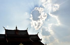 foto of canopy roof  - Clouds on Sky shine  over the roof of the castle Ratchaphruek Garden Chiang Mai - JPG