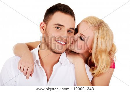 Happy young woman kissing her boyfriend
