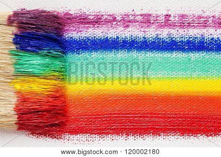 Paintbrush Bristle Closeup And Multicolor Rainbow Brush Strokes On Artist Canvas