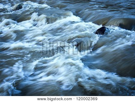 background or texture grim wild white water river